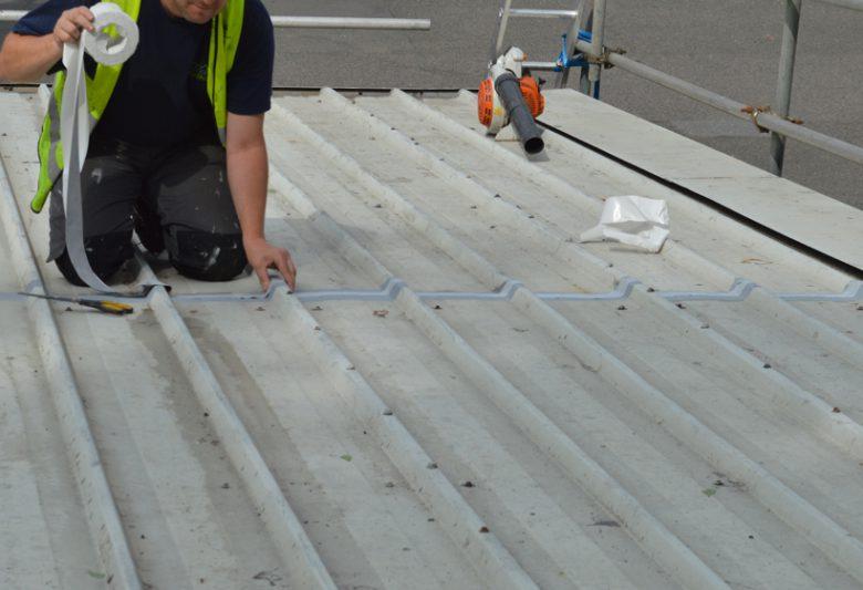 Applying tape to cut edge