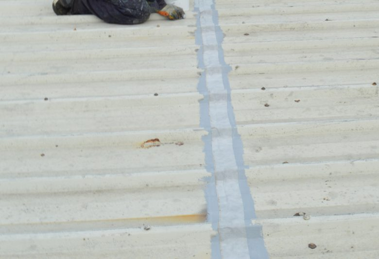 Tape applied for cut edge corrosion treatment