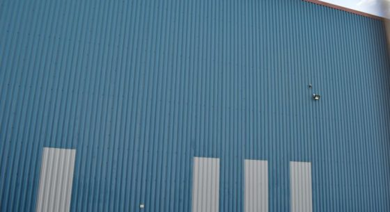 Before patchy cladding