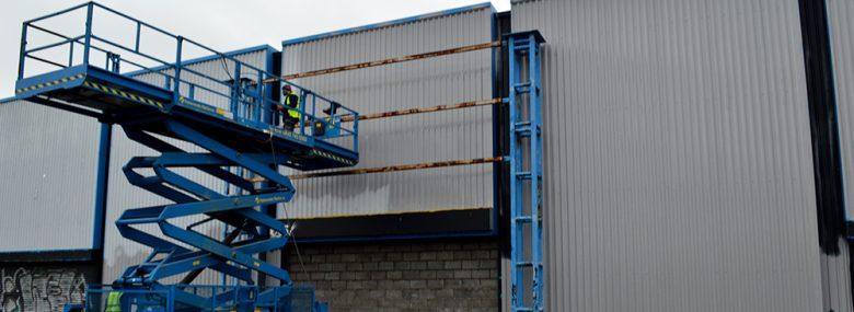 Working on site refurbishing cladding